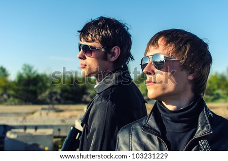 Portrait of two tough guys in glasses - stock photo