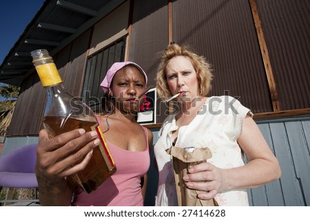 Portrait of two trashy drunk women outdoors