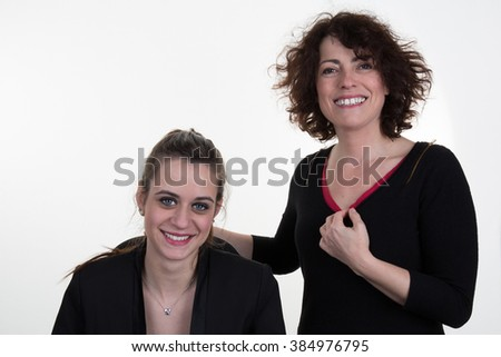 Portrait of two  woman smiling - isolated on white.