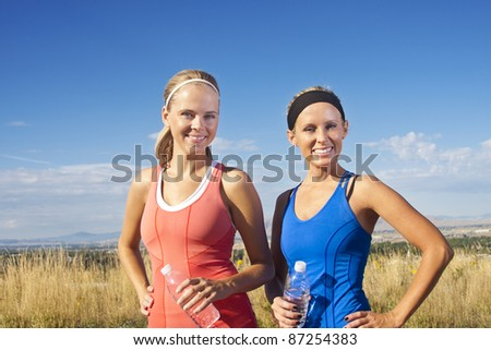 Portrait of Two women after their fitness workout - stock photo