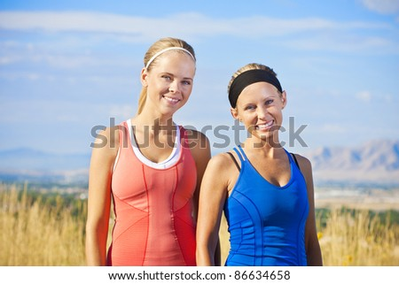 Portrait of Two women ready for a fitness workout - stock photo