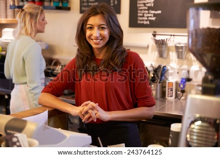 Portrait Of Two Women Running Coffee Shop Together