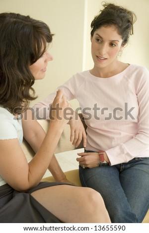 Portrait of two women talking - stock photo
