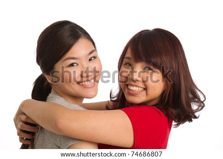 portrait of two women themed on friendship and togetherness - stock photo