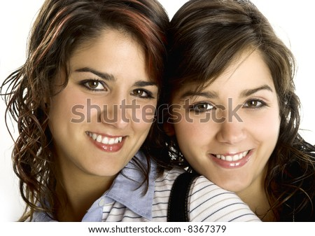 Portrait of two young and beautiful sisters - This models are twins
