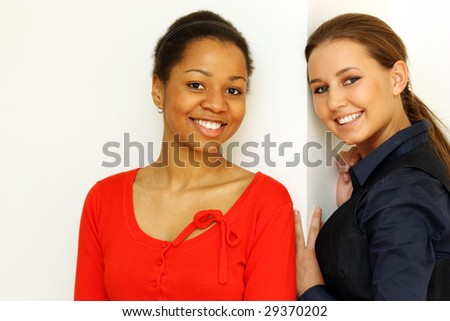 Portrait of two young beautiful girls - a studio picture - stock photo
