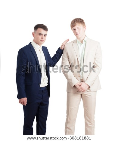 portrait of two young businessmen - stock photo