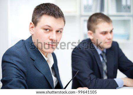 Portrait of two young businessmen in office - stock photo