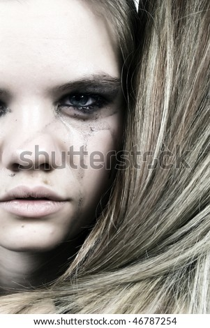 Portrait of two young crying sad girls embraces - stock photo