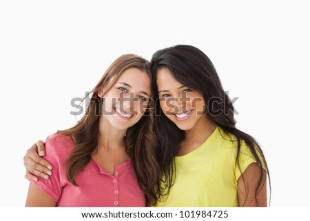 Portrait of two young friends against white background - stock photo