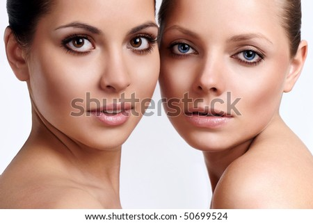 Portrait of two young girls with perfect skin - stock photo