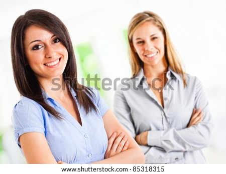Portrait of two young happy businesswomen