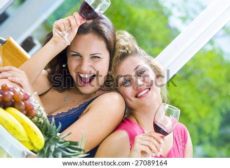 Portrait of two young happy girls having good time