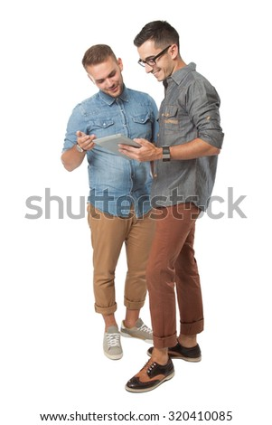 portrait of two young  man looking at a tablet pc, isolated over white background