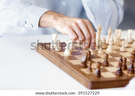 Portrait of two young man playing chess  - stock photo