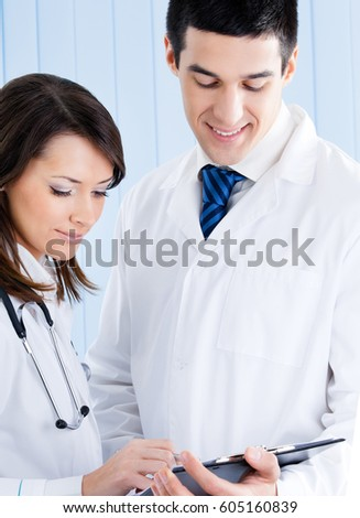 Portrait of two young medical people working together at office. Medicine and healthcare concept.