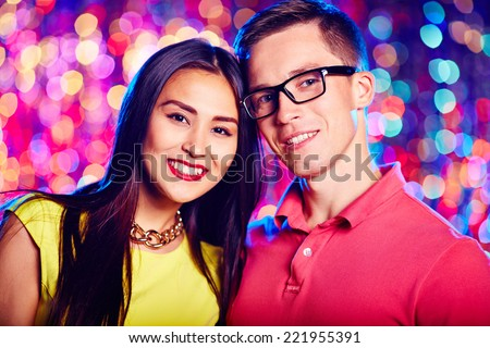 Portrait of two young people at nightclub - stock photo