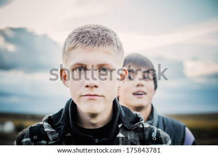 portrait of two young teenagers outdoor - stock photo