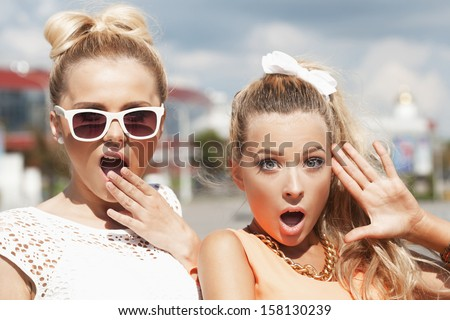 Portrait of two young woman having fun. Outdoors, lifestyle - stock photo