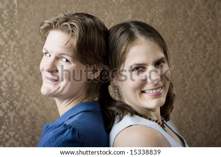 Portrait of Two Young Women Friends Back to Back - stock photo