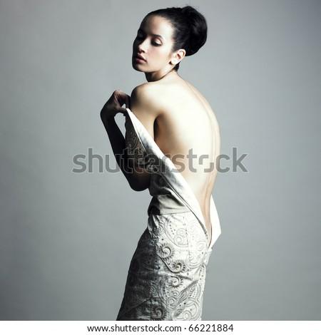 Portrait of undress elegant woman. Studio fashion photo. - stock photo