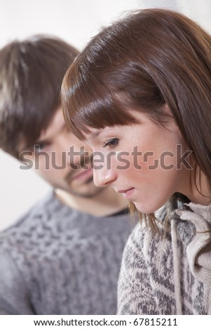 portrait of unhappy and sad couple at home - stock photo