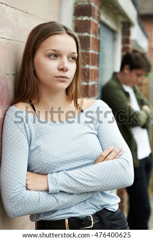 Portrait Of Unhappy Teenage Couple In Urban Setting