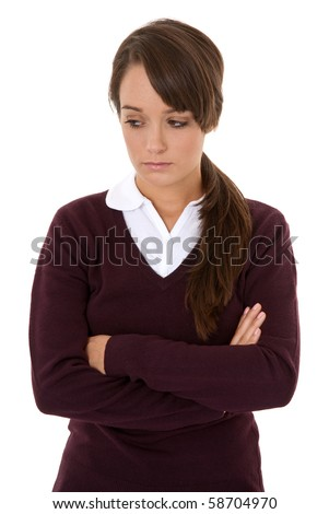 Portrait of unhappy teenage girl isolated on white - stock photo