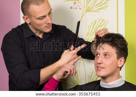 Portrait of unhappy young male with new hair style at the hairdressing salon - stock photo