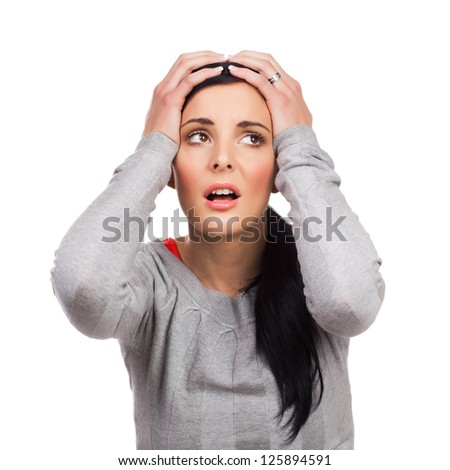 Portrait of unhappy young woman holding hands in head - isolated on white background - stock photo