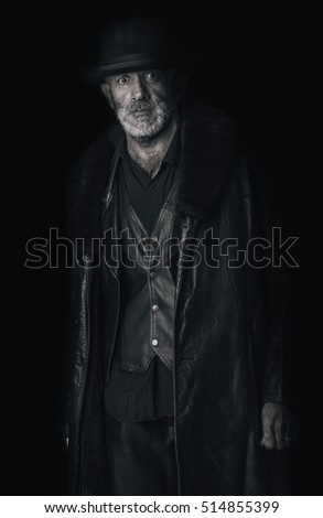 Portrait of urban senior man in low key technique