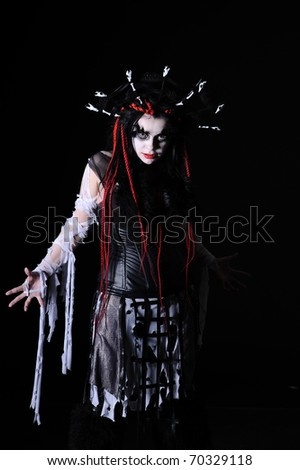 portrait of vampire woman with stage makeup isolated on black