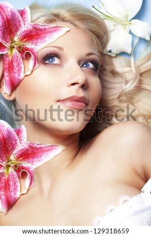 Portrait of very beautiful woman with flowers - stock photo