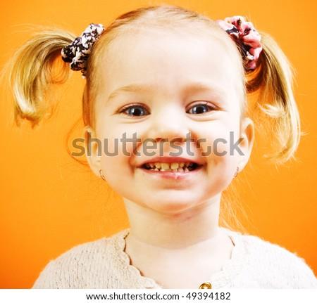 Portrait of very happy little girl - stock photo