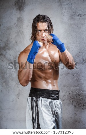 Portrait of very muscular boxer ready to fight - stock photo