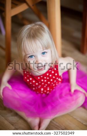 Portrait of very sweet little baby girl in rose skirt - stock photo