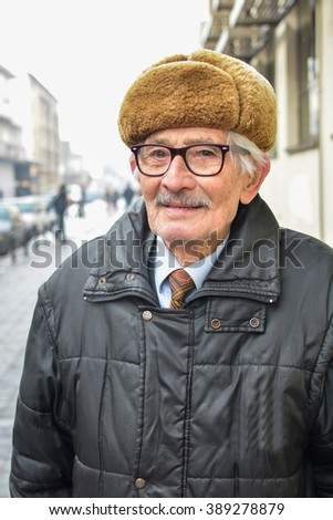 Portrait of very vital, active old man posing in the street - stock photo