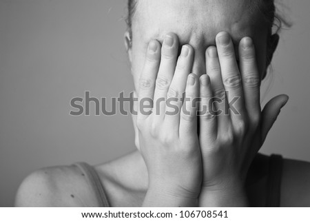 Portrait of very young depressed woman/girl(black and white) - stock photo