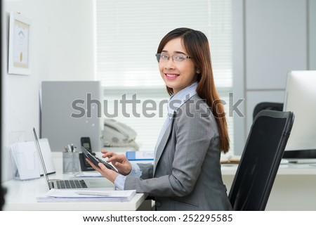 Portrait of Vietnamese female accountant working in the office - stock photo