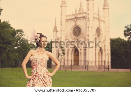 Portrait of vintage woman. The girl in the dress of the last century. Beautiful woman in long evening dress. Fairy Princess. Toned - stock photo