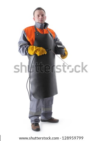 Portrait of welder wearing protective welding black leather apron, welding hood and welding electrode holder over white - stock photo