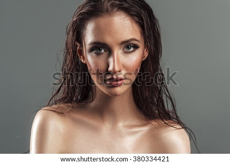 Portrait of wet hair sensual beautiful young woman. Sexy plump lips. Oil clean skin. Glamour fashion style close up photo