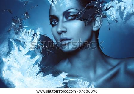 portrait of winter woman with snow splash - stock photo
