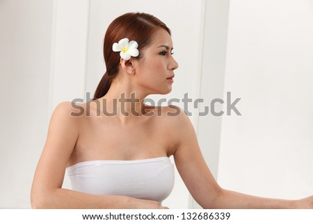 Portrait of woman against white background. - stock photo