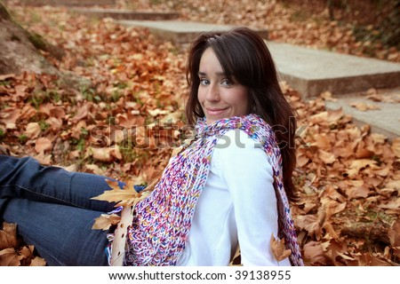 portrait of woman among autumn leaves