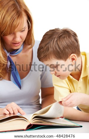 Portrait of woman and boy reading book together