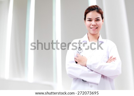 Portrait of woman Asia doctor with stethoscope at hospital corridor and office - stock photo