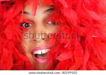 portrait of woman beauty in vivid red feather