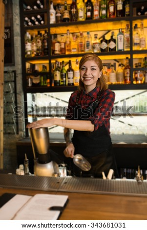 Portrait of woman cafe workers in aprons at the bar