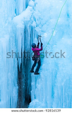 Portrait of woman climbing ice - stock photo